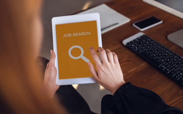 Woman looking for a job during worldwide crisis find a job online business internetand networking