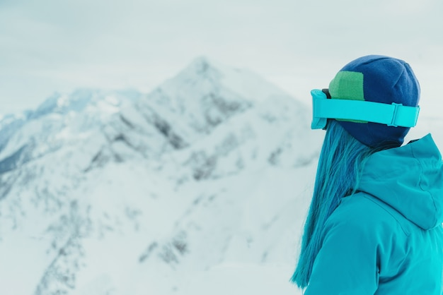 Woman looking at snowy mountains