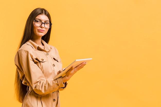 Woman looking on tablet in studio