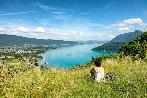 Woman looking a view of annecy lake
