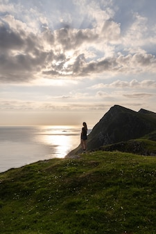 Woman looking at the view of croaghaun cliffs on achill island ireland