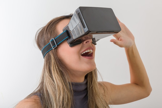 Woman looking with vr device and feeling excite