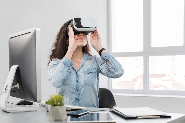 Woman looking with vr device and feeling happy