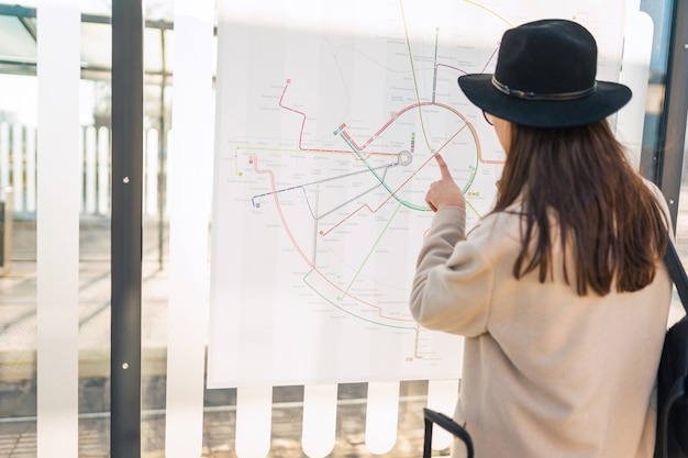 Woman looks at the city map