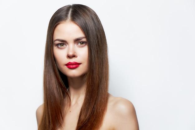 Woman looks forward confidently portrait bright makeup