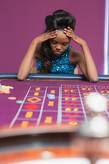 Woman losing at roulette