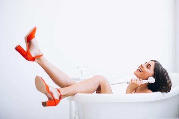 Woman lying in bathroom fashion photography