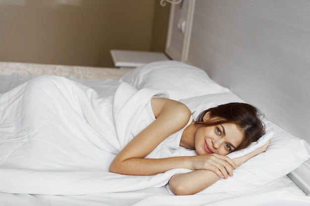 Woman lying on bed rest comfort morning weekend