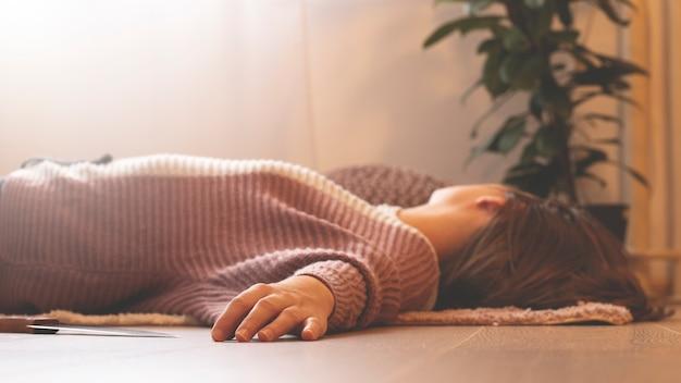 Woman lying on the floor