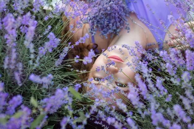 Woman lying on the grass in a field of lavender