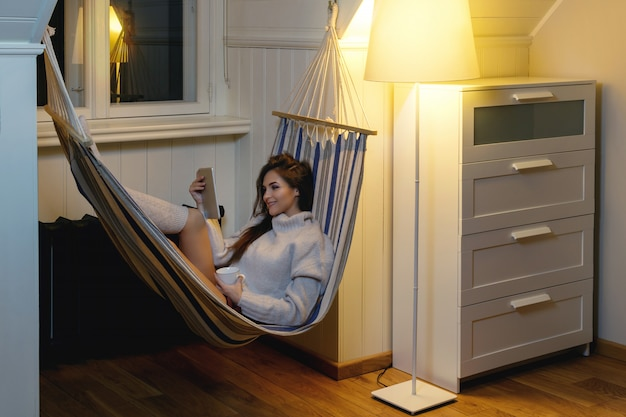 Woman lying  in the hammock
