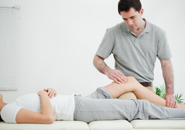 Woman lying on her back while being massaged