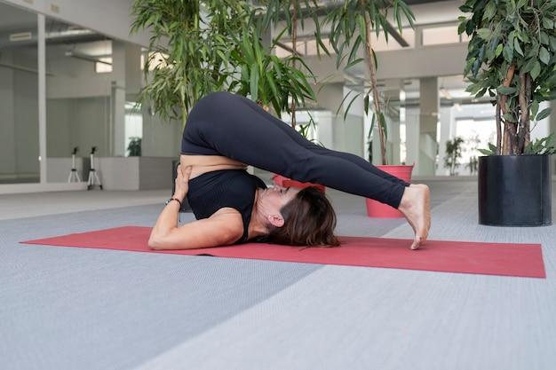 Woman lying on a mat doing aerobics