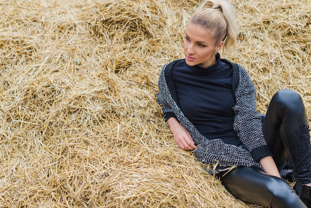 Woman lying and posing in hay