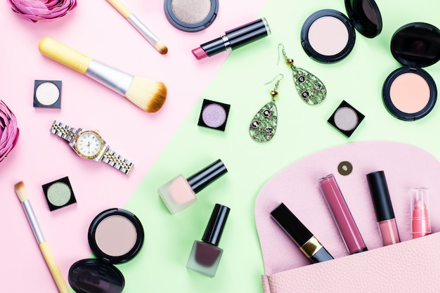 Woman make up products and accessories on pastel background