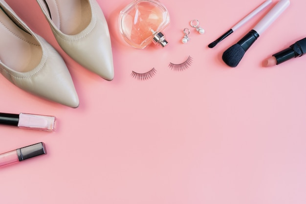 Woman makeup, cosmetics and fashion items and copy space, top view