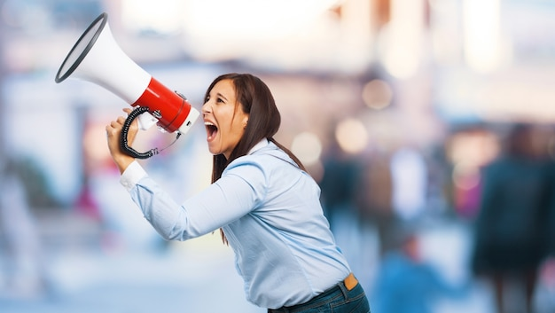 Woman making an announcement with megaphone