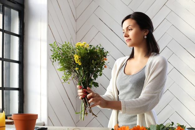 Woman making a beautiful floral bouquet