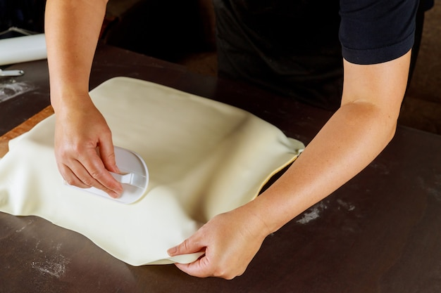 Woman making cake with fondant for party. technique of baker.