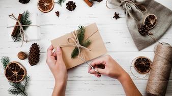 Woman making Christmas envelope