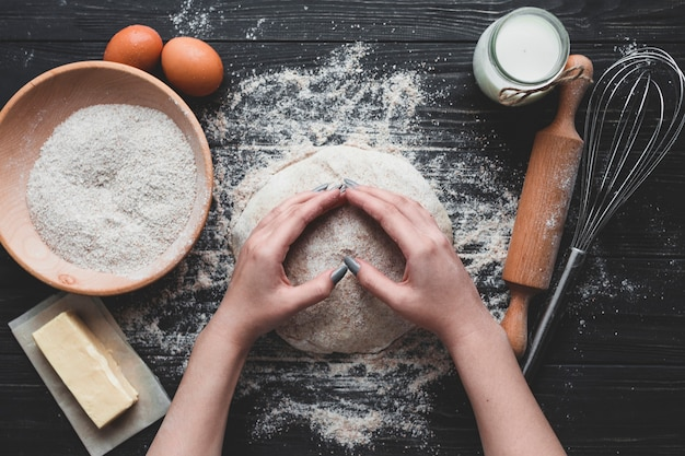 Woman making delicious bread loaf