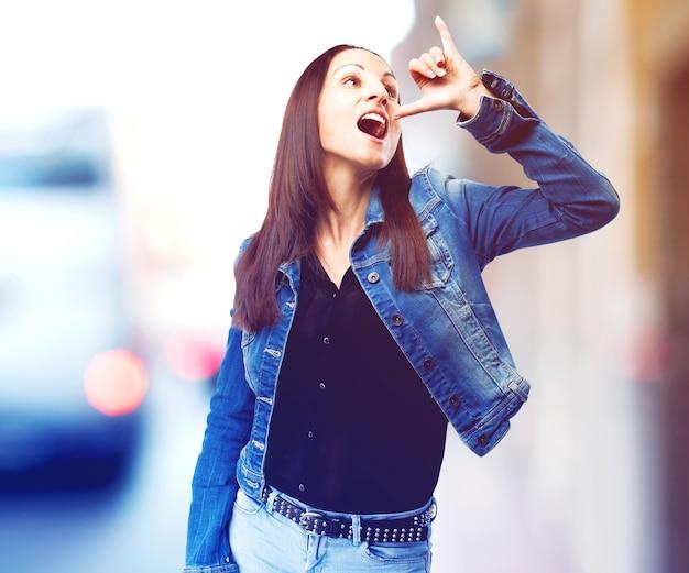 Woman making gesture drinking