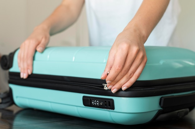 Woman making her baggage for the next vacation