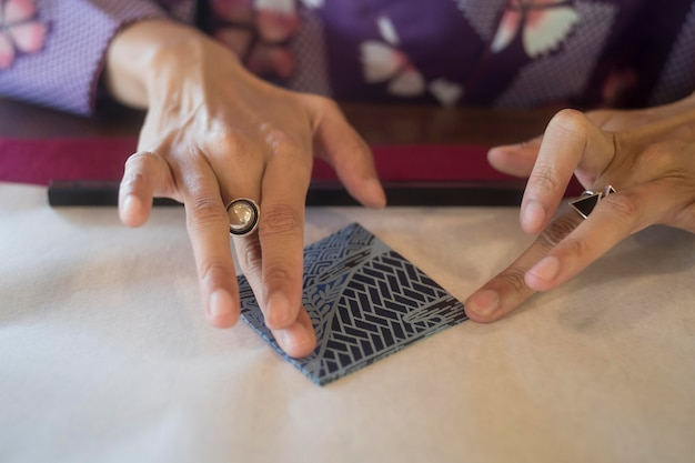 Woman making origami with japanese paper