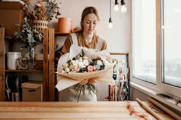 Woman making a pretty floral arrangement