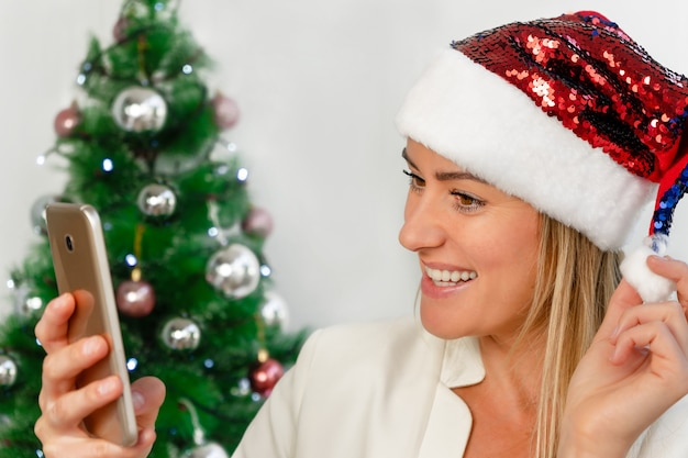 Woman making selfie with mobile in christmas
