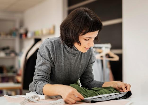 Woman making skirt at fabric