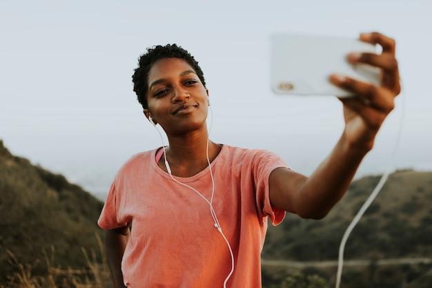 Woman making taking a selfie