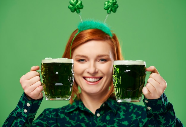 Woman making a toast to saint patrick's day