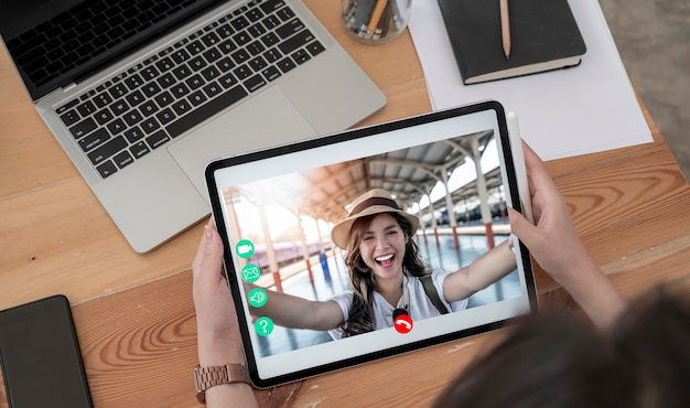 Woman making video call with her friend