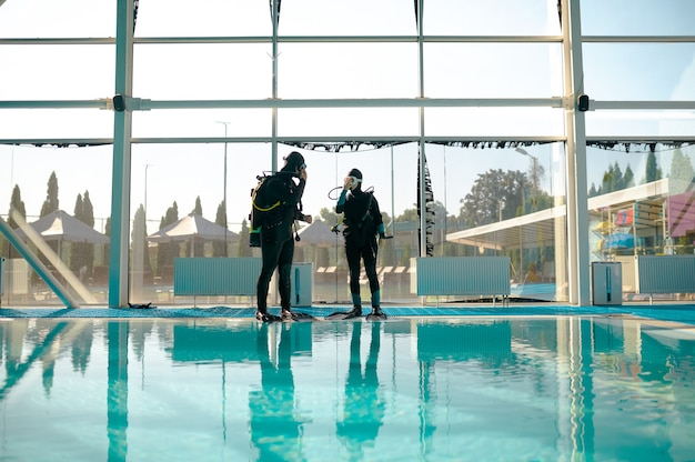 Woman and male instructor, course in diving school