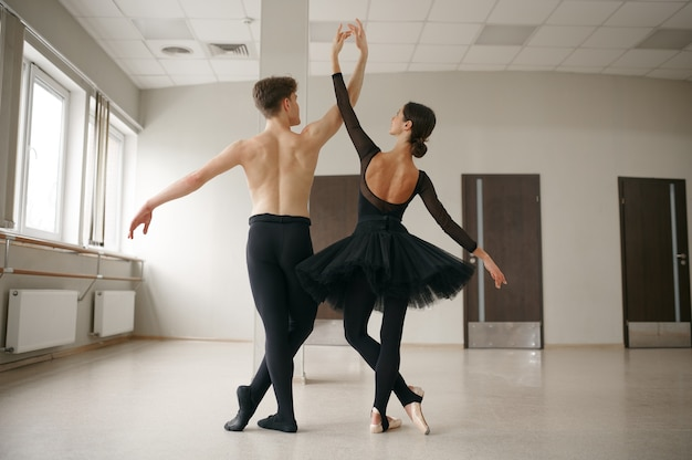 Woman and man ballet dancers in action