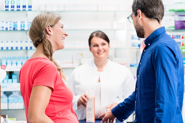Woman and man buying drugs in pharmacy