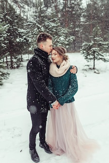 Woman and man close up portrait hugging together outdoors. loving cute tender couple in love walking in showy forest together