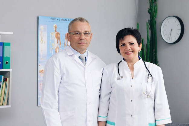 Woman and man doctors. international medics healthcare workers