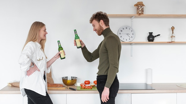 Woman and man enjoying a bottle of beer