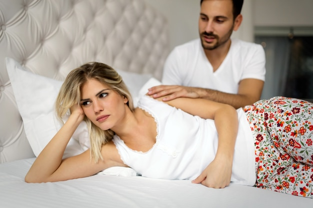 Woman and man having conflict and going through crisis in relationship