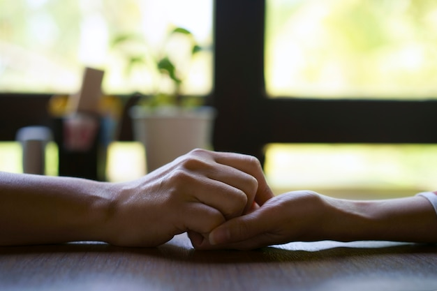 Woman and man holding hands take care together