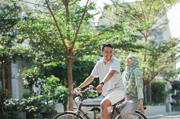 Woman and man riding a bike