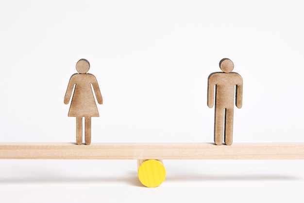 Woman and man standing on seesaw long view