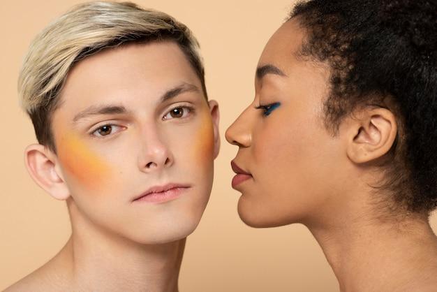 Woman and man wearing make-up