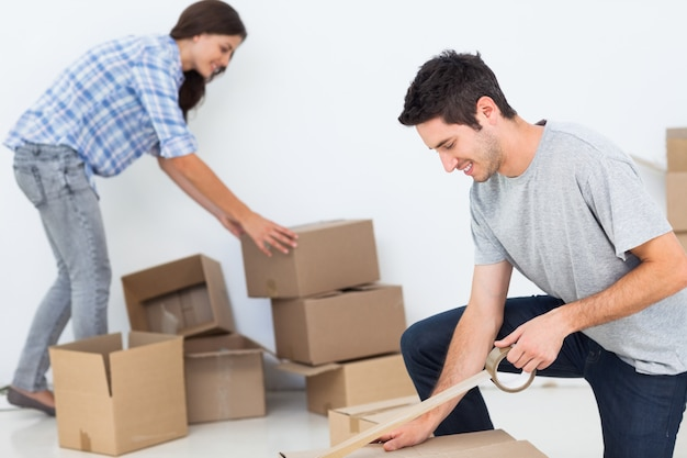 Woman and man wrapping boxes