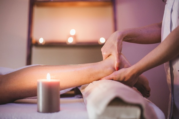 Woman massaging client's feet