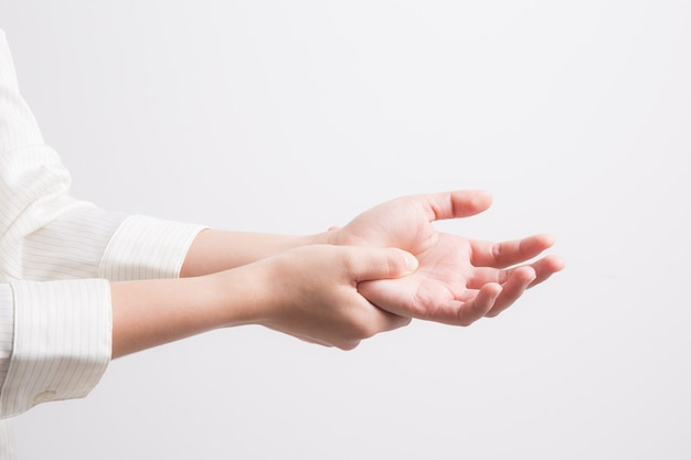 A woman massaging painful hand on a white background,office syndrome concept