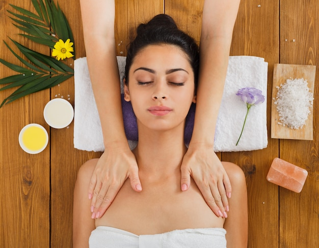 Woman massagist make body massage in spa wellness center