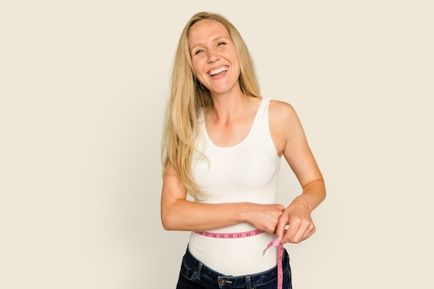 Woman measuring waist  for health and wellness campaign